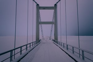 Bridge over Snowy Winter Landscape