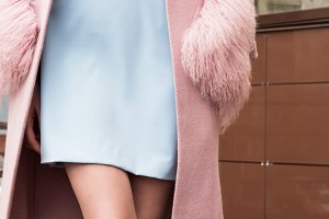 Woman Coat and blue dress