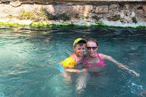 woman and her son in Cleopatra pool