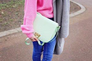 Woman with green handbag