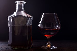 Bottle of whiskey and glass