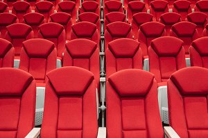 Rows of red cinema or theater seats
