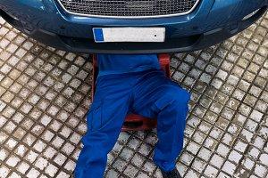 Professional Car Mechanic working.