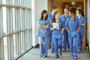 Medical students walking through corridor