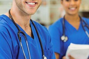Young medical students smiling at the camera