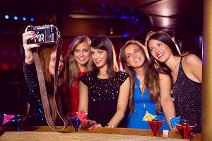 Pretty friends taking a selfie