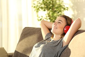 teen resting and listening music