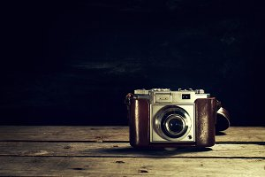 Vintage Concept. Old Camera on Wood.
