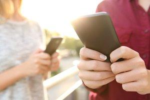 girls using smart phone
