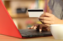 Woman hands holding a credit card