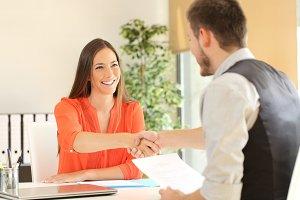 employee and boss handshaking