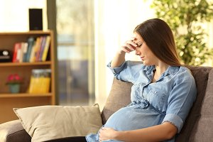 pregnant woman sitting on a couch
