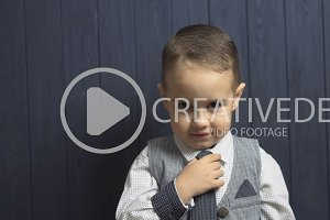Elegant Kid Boy Correct His Tie
