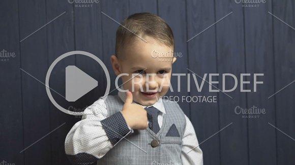 Elegant Kid Boy Shows Thumb Up