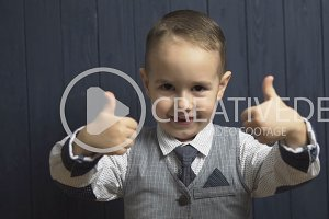 Elegant Kid Boy Shows Thumb Up