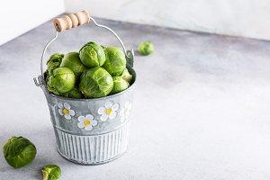 Fresh Brussels sprouts in metal bucket