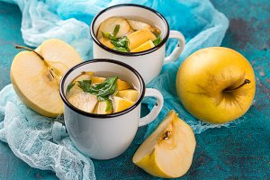 Cup of tea with apples and basil
