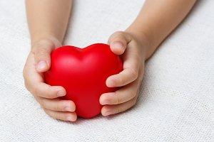 heart in baby hands