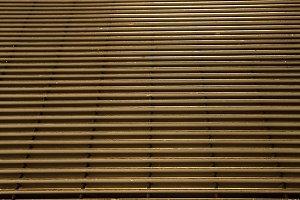 Old wall of rusty steel bars