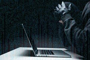 Robber hacks computer at night