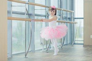 Adorable child dancing classical ballet in studio.
