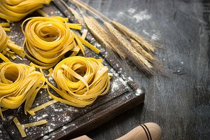 Italian raw homemade pasta tagliatelle.