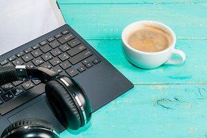 Laptop, coffee and headphones