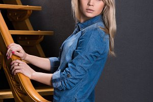 the blonde in the Studio wooden stai