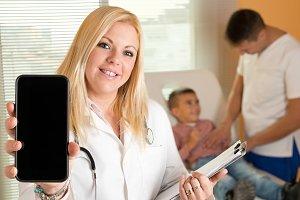 Woman pediatrician smart phone