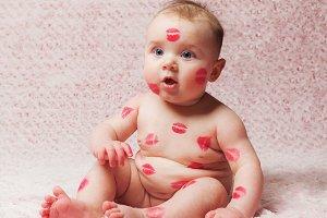 New Born Baby Girl Filled Kisses