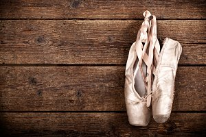 Old used pink ballet shoes