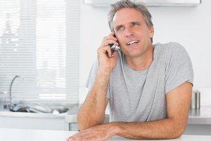 Happy man making phone call