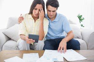 Fearful couple doing their accounts
