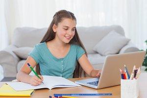 Little girl doing her homework at home