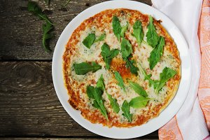 Hot pizza with cheese and rucola