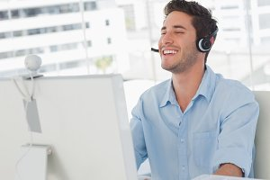 Happy designer laughing during an online communication
