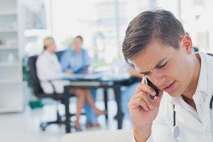 Attractive doctor calling