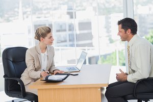 Smiling businesswoman interviewing businessman
