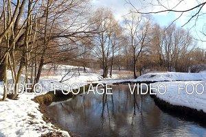 River in the winter, snow and sun glare