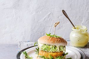 Vegan burgers with avocado, beetroot and sauce