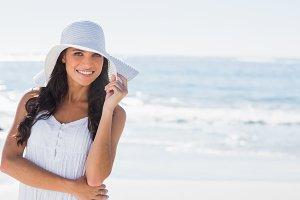 Beautiful brunette in white sunhat smiling