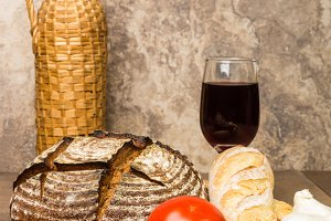 Loaf of fresh bread with wine
