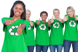 Team of female environmental activists smiling and giving thumbs up