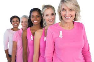 Cheerful women wearing pink and ribbons for breast cancer