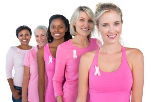 Smiling women wearing pink and ribbons for breast cancer