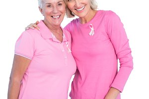 Mature women wearing pink tops and breast cancer ribbons