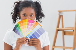 Happy woman showing colour charts
