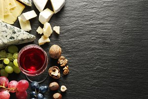 cheeses with wine glass and fruits