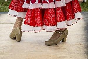 Feet of dancing folk dancer