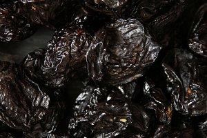 prunes on a dark background